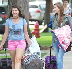 Photo of students moving in to residence hall