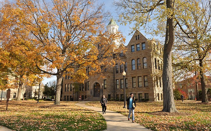 Students walk the historic BW campus in autumn.