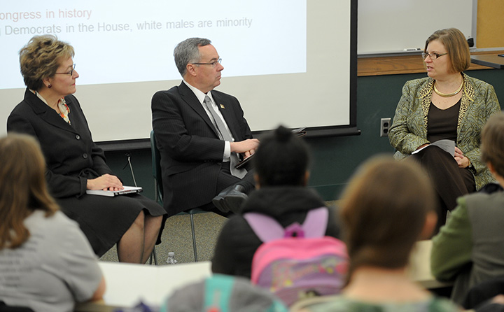 photo: Marcy Kaptur, Bob Helmer and Barb Palmer speaking to a BW class