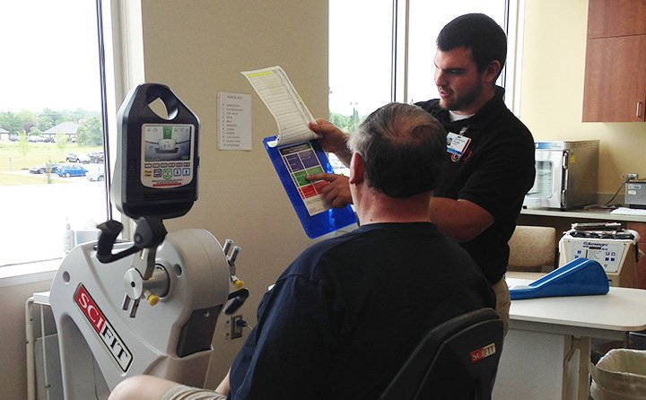 Tyler Shaffer '16 with cardiac rehab patient