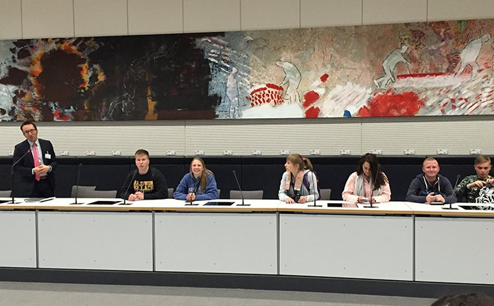 Students participating in BW's Seminar in Germany meet in the German capitol building complex (Reichstagsgebäude) in the plenary meeting room of the Social Democratic Party.
