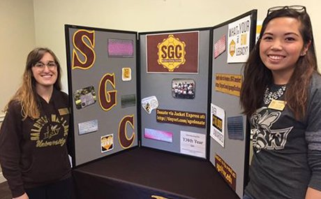 Two sophomore class officers and SGC members educating their peers on the importance of philanthropy and how their contributions help their fellow students and community.