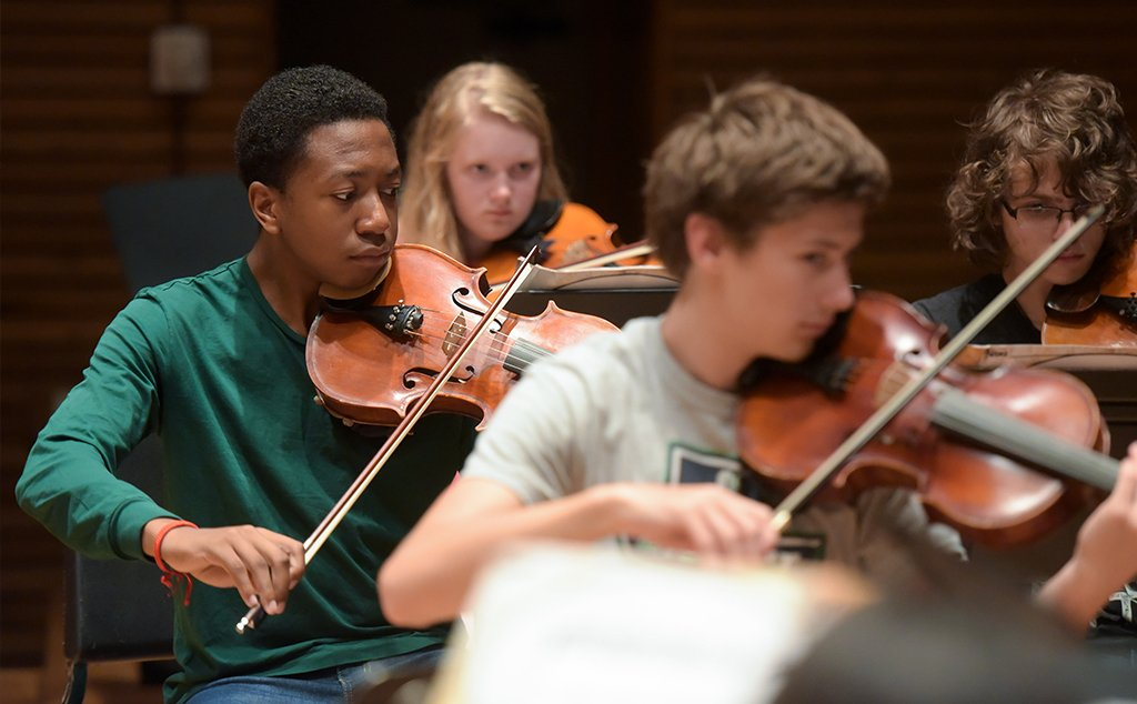 Students rehearse in an orchestra at the BW Community Music School.