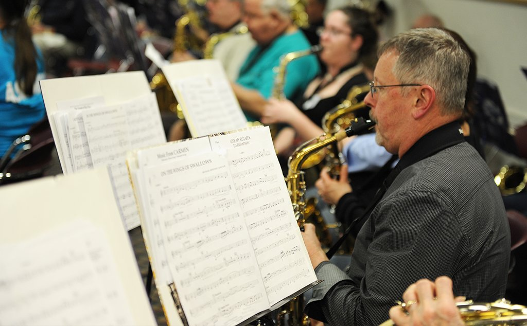 A group of adults at a New Horizons Band rehearsal