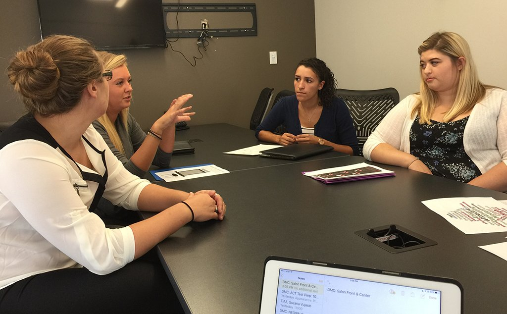 Digital Marketing Clinic students provide consultation to a local business owner.