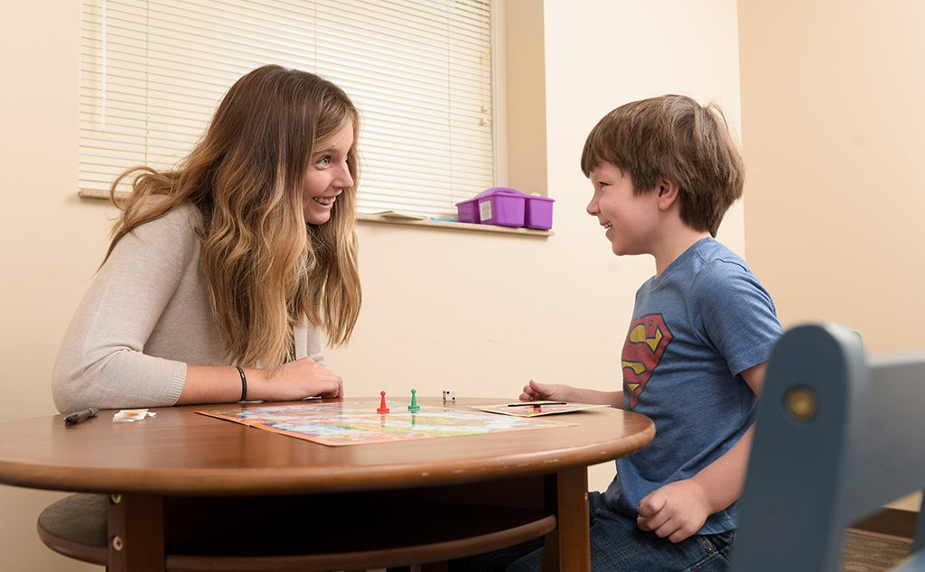 A speech-language pathology student provides therapy to a boy at the BW Speech Clinic.