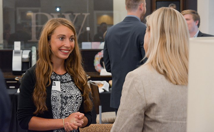 One Year MBA Networking event in the Welcome Center with MBA alumni association members who will be mentors for the current group one year MBA students.