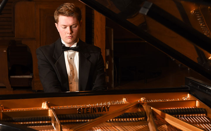 Photo showing student playing Steinway