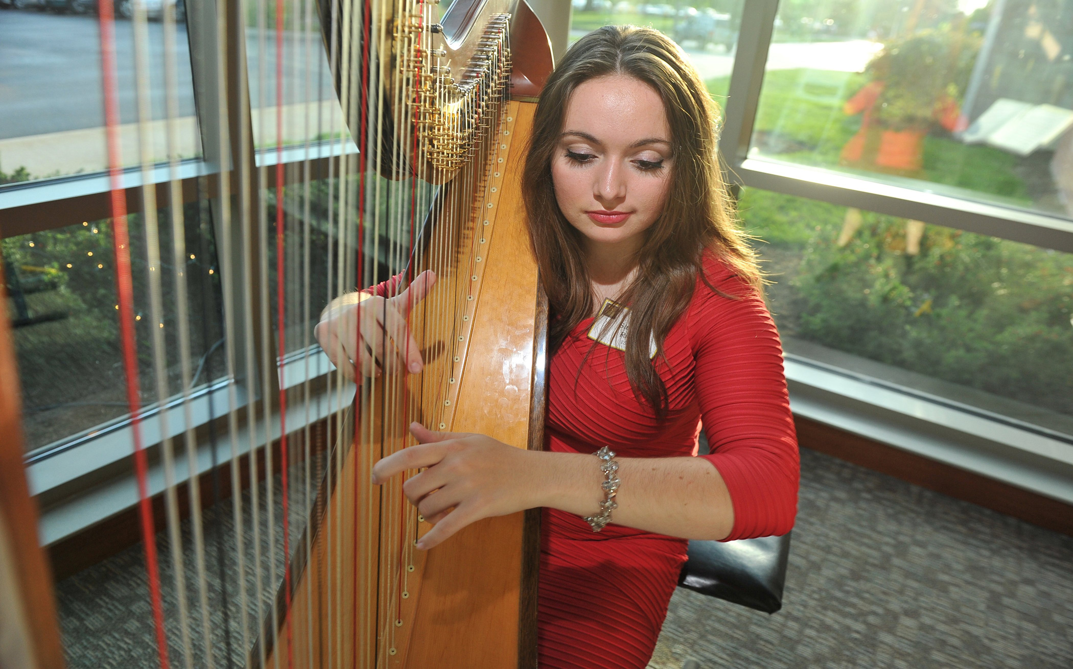student harpist performing