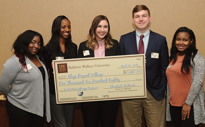 Photo of BW students with award check