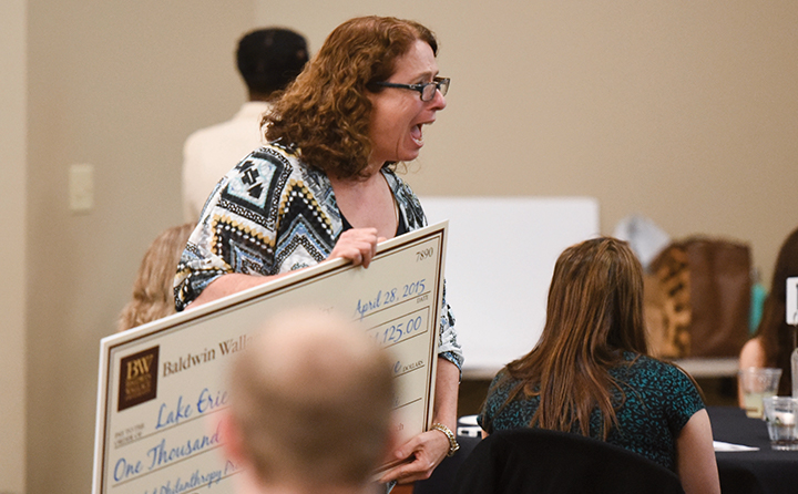 Photo of woman receiving award check