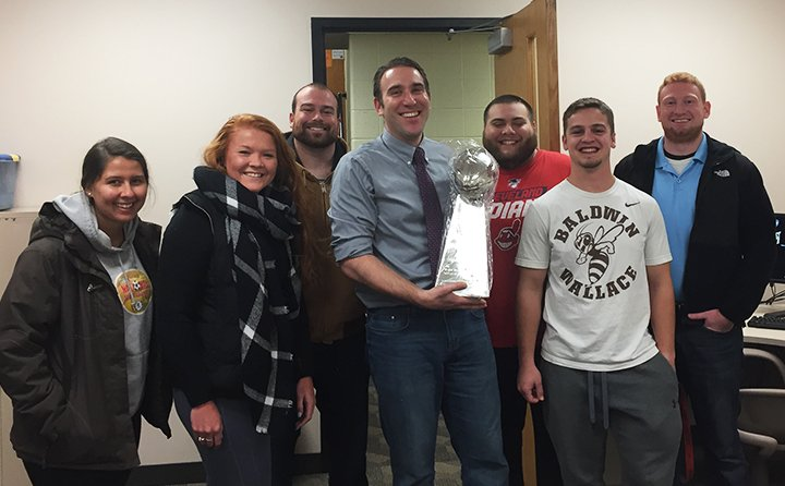 BW students honor Dr. Charles Campisi with a Lombardi Trophy.