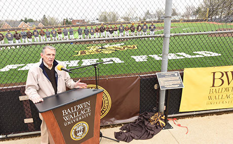 Coach Bob Fisher speaks at the dedication of Fisher Field at BW