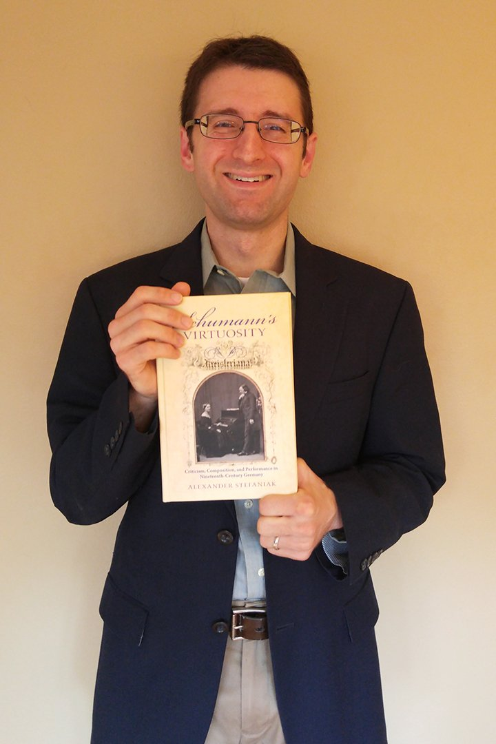 "Alex Stefaniak with his book ""Schumann's Virtuosity"""