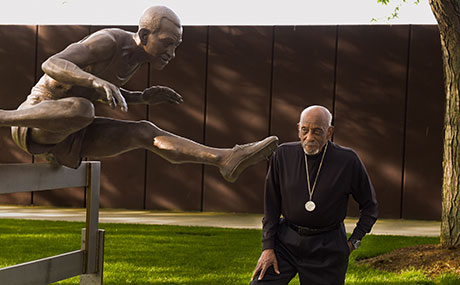 A bronze likeness of Harrison Dillard stands outside Finnie Stadium at BW