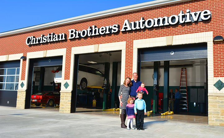 Kevin Kaschube and family outside Christian Brothers Automotive