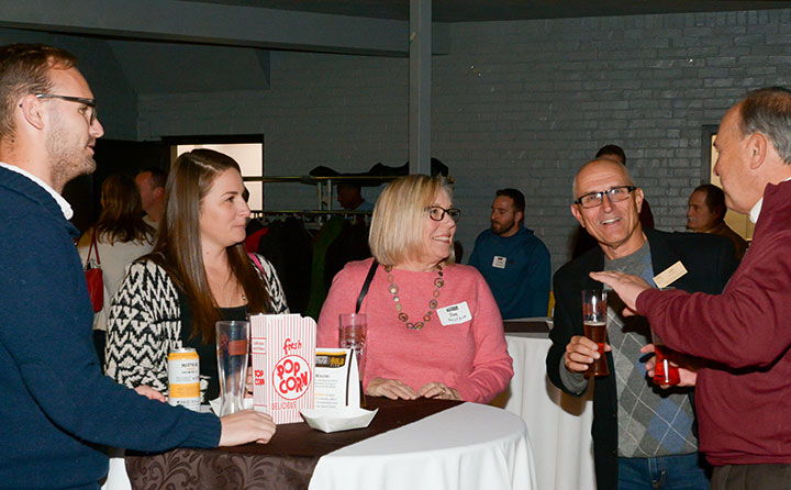 Guests enjoy Baldwin Wallace Brown and Gold launch party