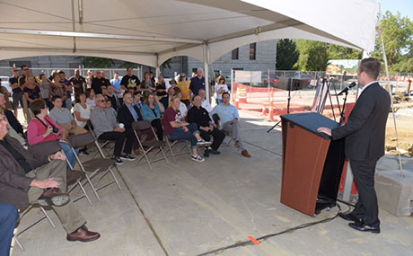 Kevin DiGeronimo, principal of the development company, addresses the community crowd gathered for the groundbreaking.