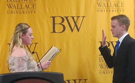 Kevin Kaufhold takes the oath of office as BW student body president