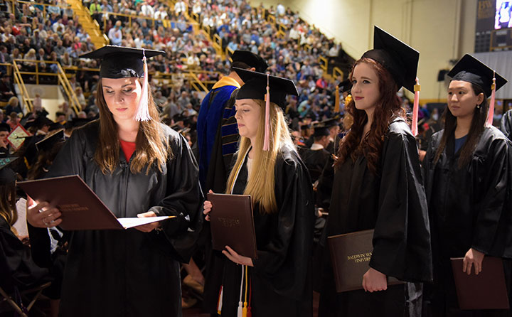 Baldwin Wallace University grads admire diplomas at spring 2017 commencement