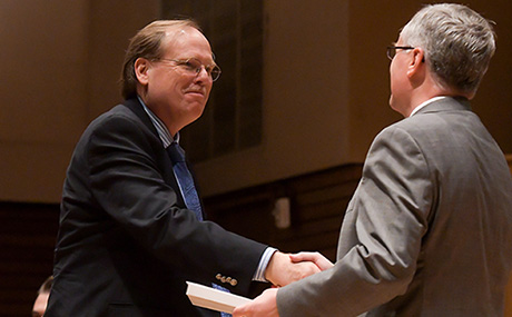 President Bob Helmer presents the Student Senate Faculty Excellence Award to Dr. Thomas Sutton.