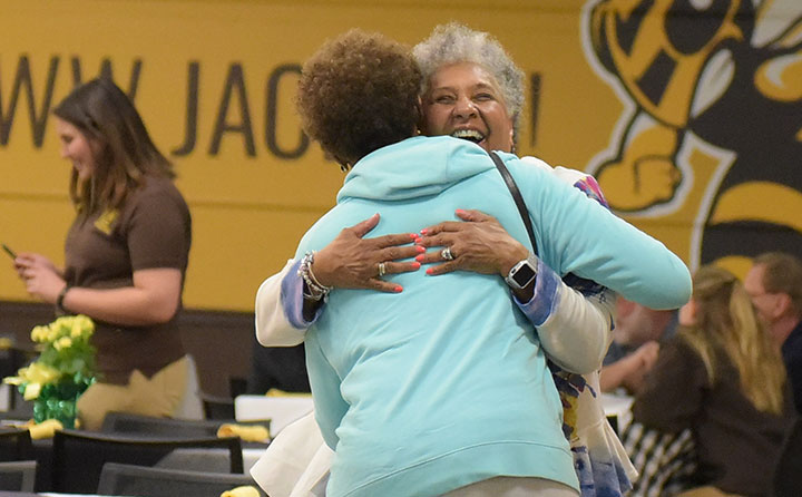 Two grads embrace at Baldwin Wallace University alumni celebration