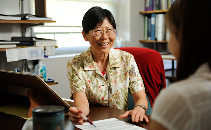 Baldwin Wallace mathematics faculty member, Dr. Chungsim Han, meets with a student