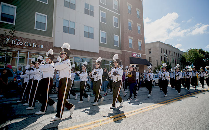 The Yellow Jacket Marching Band parades down Front Street for BW's Bold & Gold Homecoming.