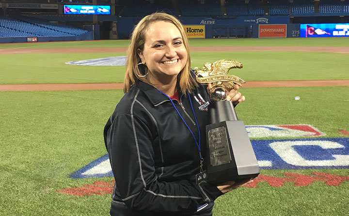 Baldwin Wallace graduate Penny Forster with the 2016 American League championship trophy