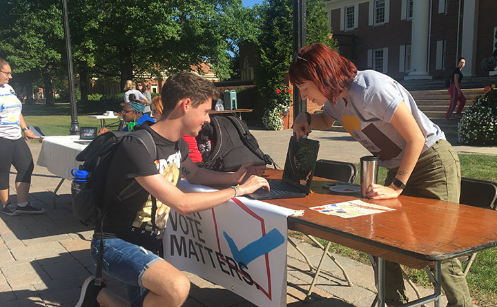 "Ally Crays registers a fellow student  to vote as part of the ongoing ""Jackets Engaged"" initiative."