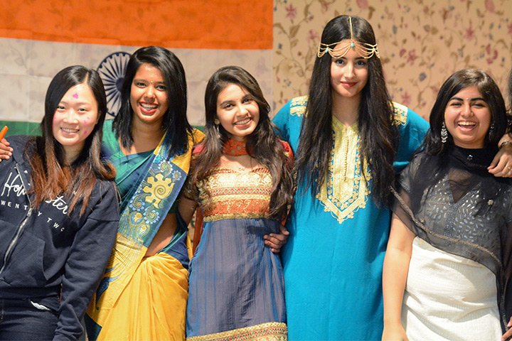 female students in cultural dress