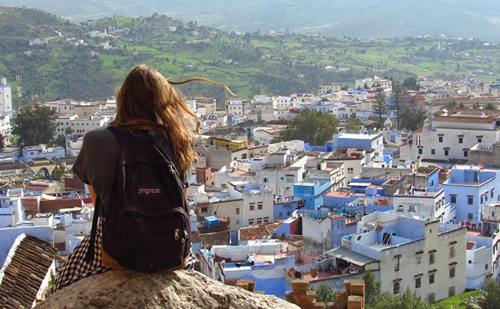 A study abroad student in Morocco, overlooking a town.