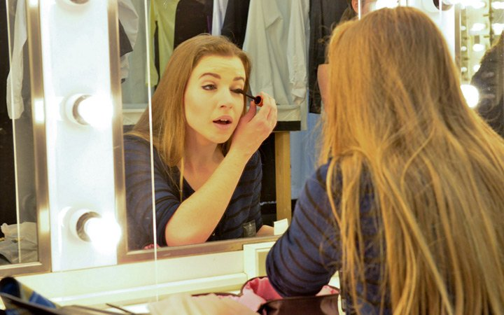 Music Theatre student applying makeup