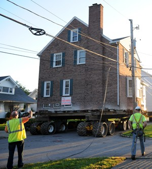 Photo of house being moved on a trailer