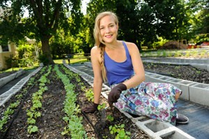 Rebecca Newbould planting in BW's campus garden
